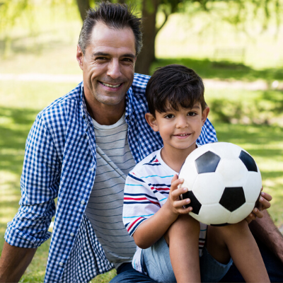 Father and son with soccer ball