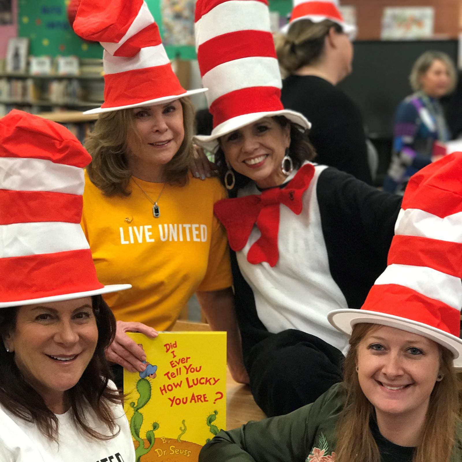 women in dr. seuss hats